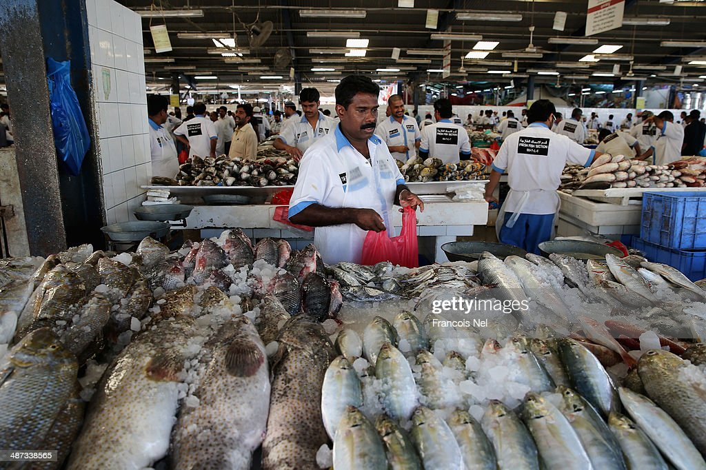 A vendor waits for for customers at the Deira Fish Market on April 29, 2014 in Dubai, United Arab Emirates.