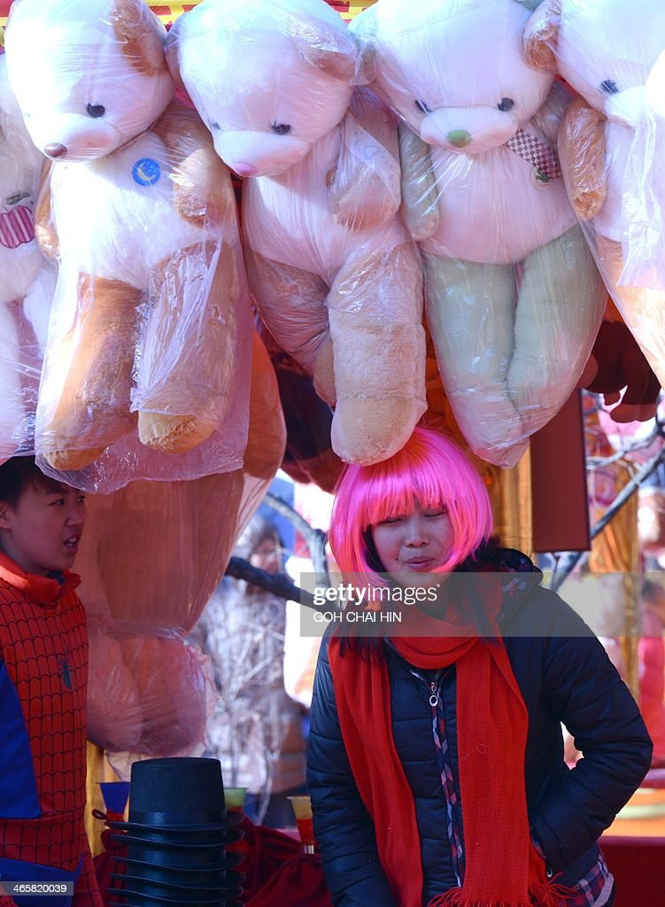 A vendor waits for visitors at the Ditan park temple fair in Beijing on January 30, 2014, on the eve of the Lunar New Year. Over a billion Chinese in China and millions more all over the world will be celebrating the Lunar New Year, known as the Spring Festival in China.
