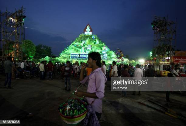 A vendor waits in front of a worship venue for his sale on the beginning day of the Durga Puja festival in the eastern Indian state Odisha's capital...