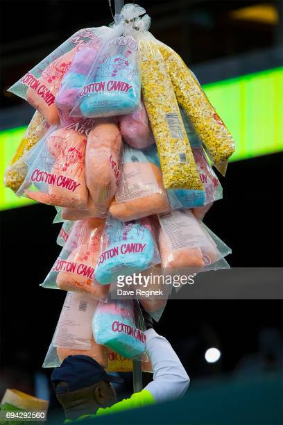 A vendor walks the isles selling popcorn and cotton candy during a MLB game between the Detroit Tigers and the Los Angeles Angels at Comerica Park on...