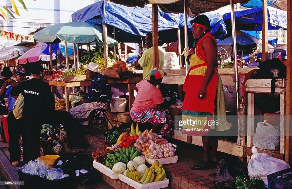Vendors at fruit stalls at Public Market.