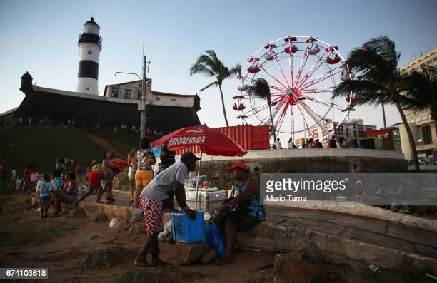 Vendors gather in front of the Barra lighthouse on April 19 2015 in Salvador Brazil