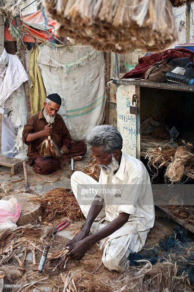 Vendors make koochi (jute brushes) in Karachi, Pakistan, on Wednesday, May 8, 2013. Pakistan is to hold parliamentary elections on May 11. According to opinion polls, Nawaz Sharif of the Pakistan Muslim League-N (PMLN) leads Imran Khan of Pakistan Tehrik-e-Insaf (PTI) in the race to replace president Asif Ali Zadari and become Pakistan's 12th president. Photographer: Asim Hafeez/Bloomberg via Getty Images