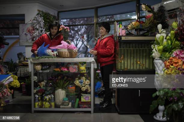 Vendors prepares flowers for Mother's Day at a flower shop in Pyongyang on November 16 2017 North Koreans in Pyongyang typically mark Mother's Day...