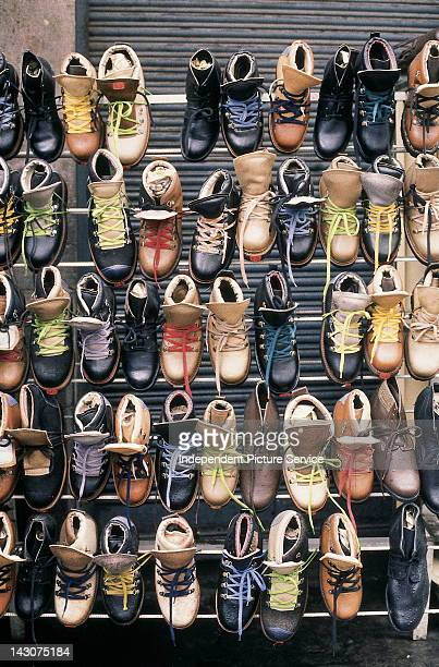 Vendor's rack of shoes and boots in Quito Ecuador