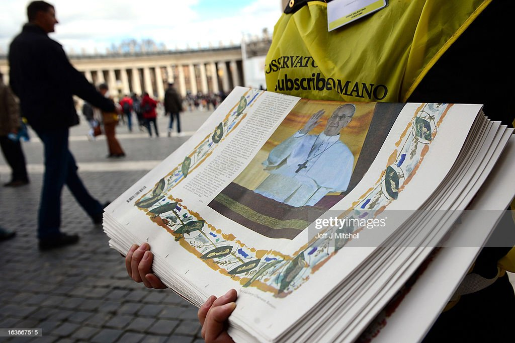 Vendors sell copies of the L'Osservatore Romano in St Peters square on March 14, 2013 in Vatican City, Vatican. A day after thousands gathered in St Peter's Square to watch the announcement of the first ever Latin American Pontiff it has been announced that Pope Francis' inauguration mass will be held on March 19, 2013 in Vatican City.