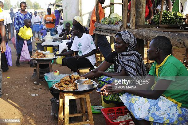 MCCONNELL*** Vendors sell food at the Kogelo market on July 13 2015 in Kisumu Excitement is growing in Kenya ahead of Barack Obama's first visit to...
