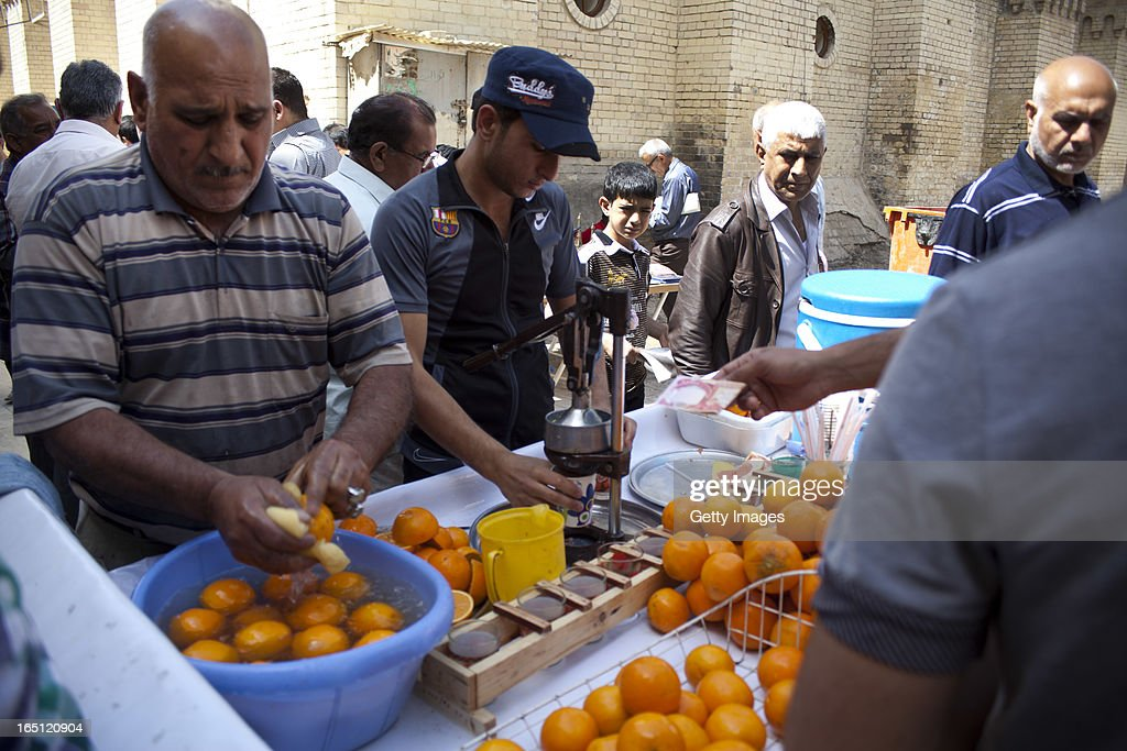 Vendors sell fresh fruit juice in Qushla park outside the Baghdad Cultural Centre on March 29, 2013 in Baghdad, Iraq. Ten years after the regime of Saddam Hussein was toppled from power, Baghdad continues to show the scars of the war. In vast areas, infrastructure is fractured and basic services are lacking, however, some areas of the capital are showing promising signs of recovery.