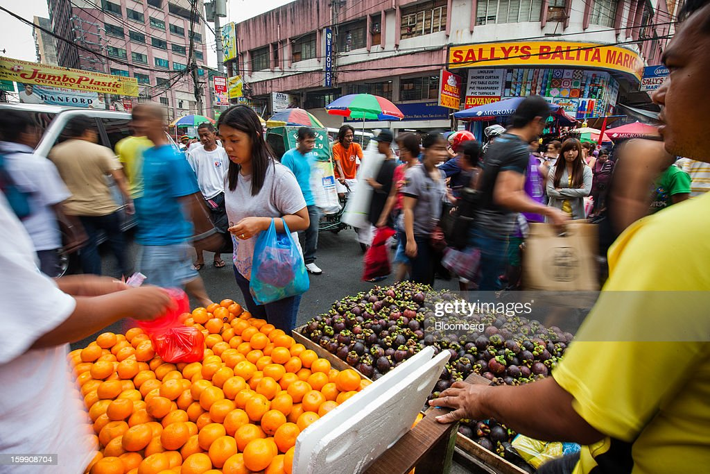 Vendors sell fruit at the Divisoria market in Manila, the Philippines, on Tuesday, Jan. 22, 2013. Philippine government bonds advanced on speculation the central bank will hold its benchmark interest rate at a record low at a meeting tomorrow, supporting demand for the nation's debt. Photographer: Julian Abram Wainwright/Bloomberg via Getty Images