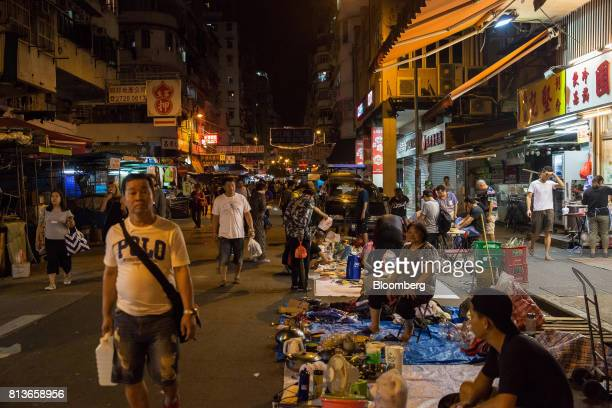 Vendors sell goods at street stalls at night in the Sham Shui Po district of Hong Kong China on Thursday May 18 2017 Sham Shui Po is a district of...