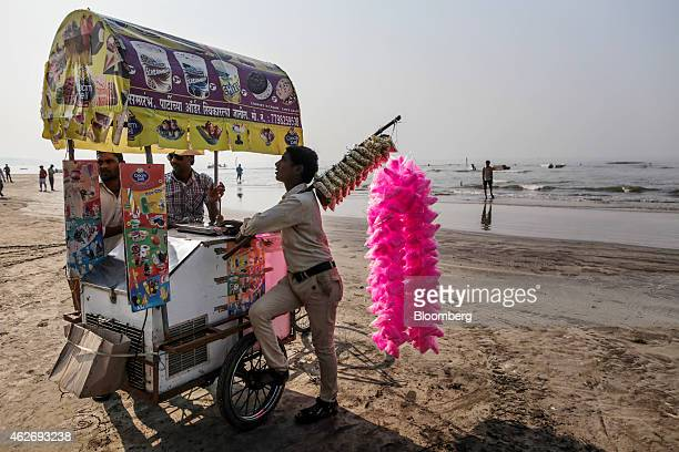 Vendors sell ice cream and cotton candy at a beach in Alibag Maharashtra India on Sunday Feb 1 2015 Indian central bank Governor Raghuram Rajan left...