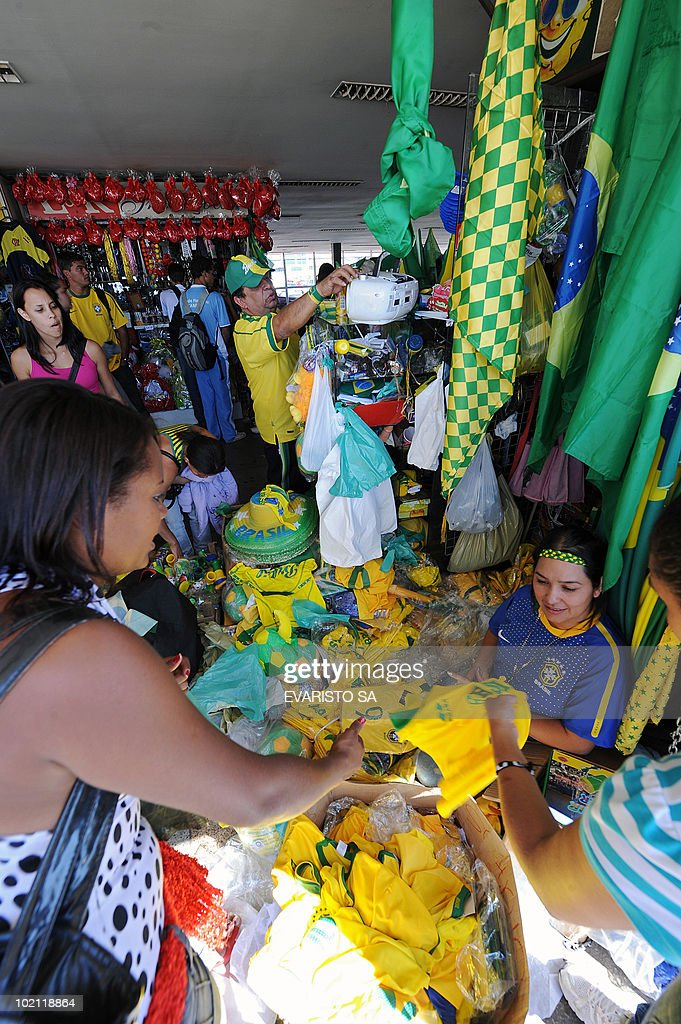 Vendors sell jerseys of the Brazilian national football team at Brasilia's bus station on June 15, 2010, before the FIFA World Cup South Africa 2010 match between Brazil and North Korea. AFP PHOTO/Evaristo SA