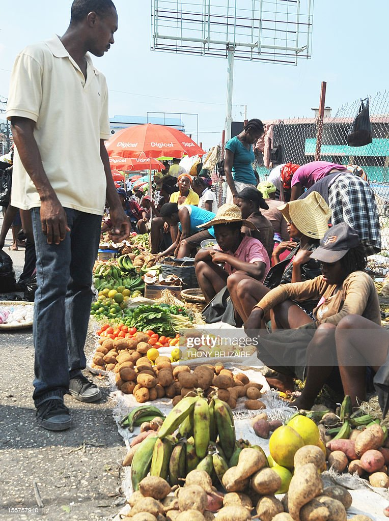Vendors sell produce November 20, 2012 in a market place in Petion-Ville, Haiti. Food prices and the cost of living has skyrocketed in the wake of Hurricane Sandy, the deadly storm that tore through the Caribbean long before reaching America. Farmers in southwest Haiti, already struggling, said they had 'lost everything' after the tropical storms that have hit the island this year. 'I am ruined. I lost everything. I invested more than 50,000 gourdes (about 2,000 dollars),' said Dieunord Elismé, a farmer of 27 years, who also lost his home. 'Now, we must all over again.' As Dieunord, many small farmers have seen their investment disappear.'We've been hit twice,' he recalls. And when Hurricane Sandy late October, high winds and floods destroyed vegetable crops that were on the eve of the harvest. Livestock, plantations and houses were swept away, melting all the savings of farmers. The industry has lost a total of $ 104 million. Haiti, which produced approximately 50% of its food needs, will fall below 40% because of bad weather, also warn agricultural experts. AFP PHOTO / Thony BELIZAIRE