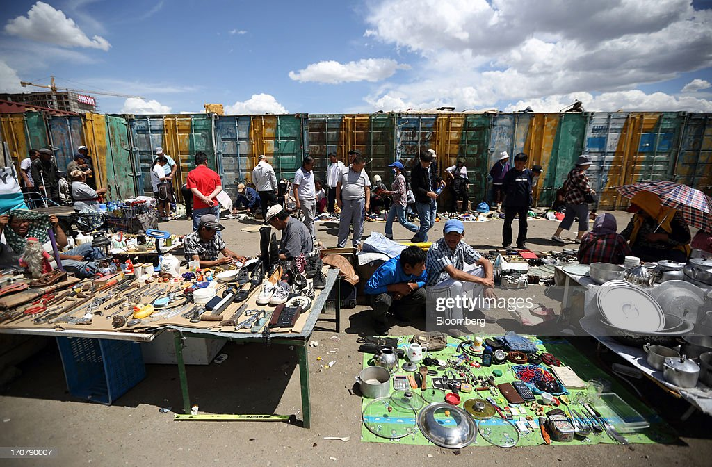 Vendors sell products at a market in Ulaanbaatar, Mongolia, on Thursday, June 13, 2013. Mongolia, a country of almost 2.9 million people, is experiencing double-digit growth and new opportunities in the mining industry. Photographer: Tomohiro Ohsumi/Bloomberg via Getty Images