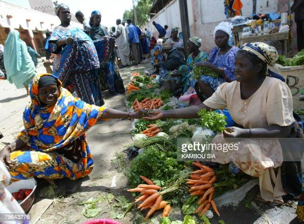 Vendors sell their produce on Feburary 8 2008 near the enterance of N'djamena's central market after it was burntdown during fighting between...