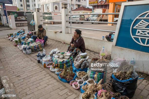 Vendors sell traditional herbs are displayed for sale on a street in Vientiane Laos on Thursday Nov 2 2017 Located in the Mekong region Southeast...