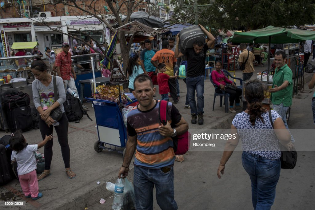 Vendors sells items near the San Antonio International Border in Cucuta, Colombia, on Thursday, Sept. 21, 2017. For weeks, Venezuelans have been flocking by the busload to San Antonio del Tachira, a border town of some 62,000 residents, fleeing as President Nicolas Maduro consolidates autocratic power. According to Colombia's migration authority, the number of foreigners entering Cucuta, the first major city across the bridge, more than doubled this summer. Photographer: Nicolo Filippo Rosso/Bloomberg via Getty Images
