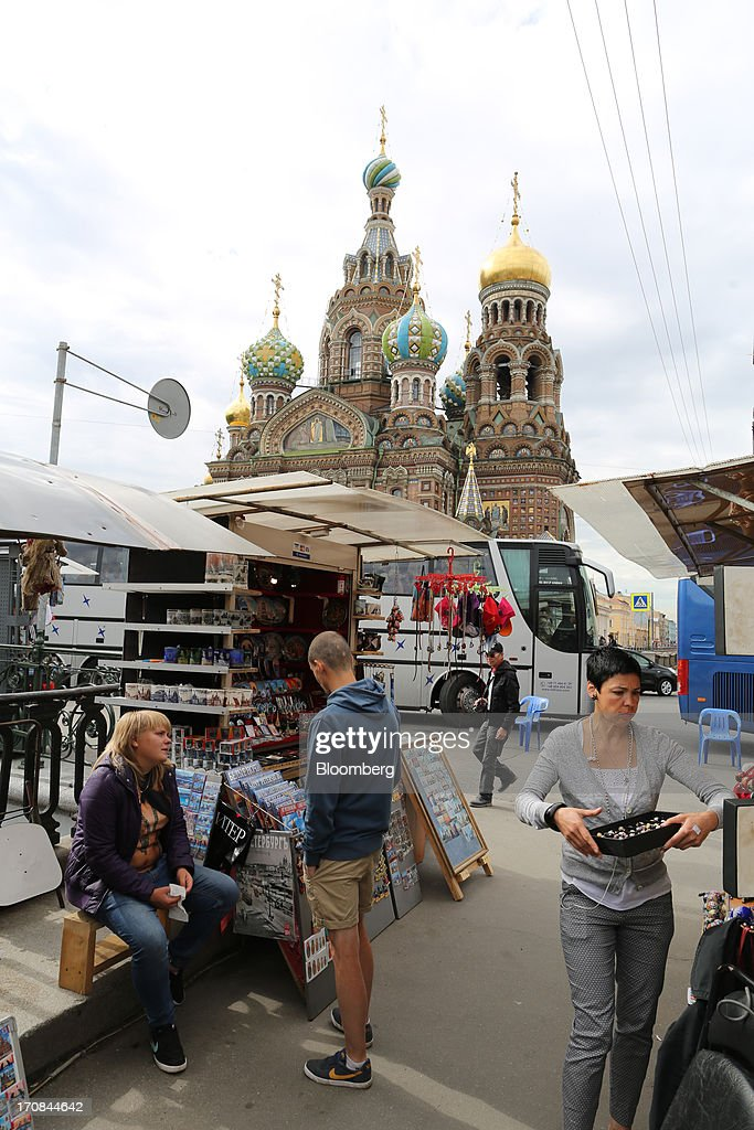 Vendors set up their souvenir stalls at a market near the Church of the Saviour on Spilled Blood ahead of the St. Petersburg International Economic Forum 2013 (SPIEF) in St. Petersburg, Russia, on Wednesday, June 19, 2013. The Russian Deputy Prime Minister Igor Shuvalov told the conference that the country's World Trade Organization accession negotiations could be further delayed unless several remaining disputed matters are solved. Photographer: Andrey Rudakov/Bloomberg via Getty Images
