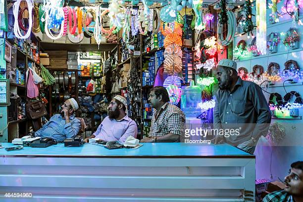 Vendors sit waiting for customers at a lighting store in the Null Bazar market area in Mumbai India on Thursday Feb 26 2015 India's Finance Minister...