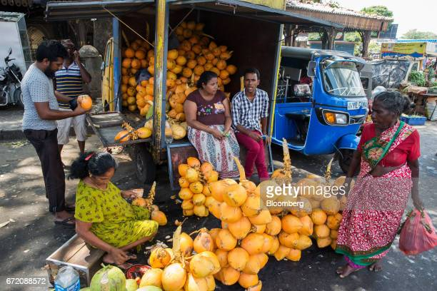 Vendors wait for customers at a stall selling coconuts in the Pettah neighborhood of Colombo Sri Lanka on Thursday April 20 2017 The Central Bank of...