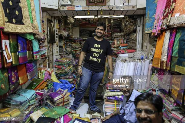 Vendors wait for customers at a wholesale store selling saris inside Mangaldas Market in Mumbai India on Saturday May 13 2017 A Goods and Services...