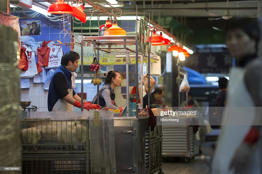 Vendors wait for customers at the Kowloon City Market in Hong Kong, China, on Thursday, April 11, 2013. The Hang Seng Index rose 0.8 percent to 22,220.65 as of 1:14 p.m. in Hong Kong, headed for its longest winning streak since March 27. The gauge is close to erasing last week's loss prompted by the outbreak of a new strain of bird flu in China. Photographer: Jerome Favre/Bloomberg via Getty Images