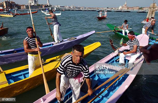 Venetian gondoliers participate to a rowing competition to celebrate the Festa del Redentore in Venice July 18 2004 This festival is second only to...
