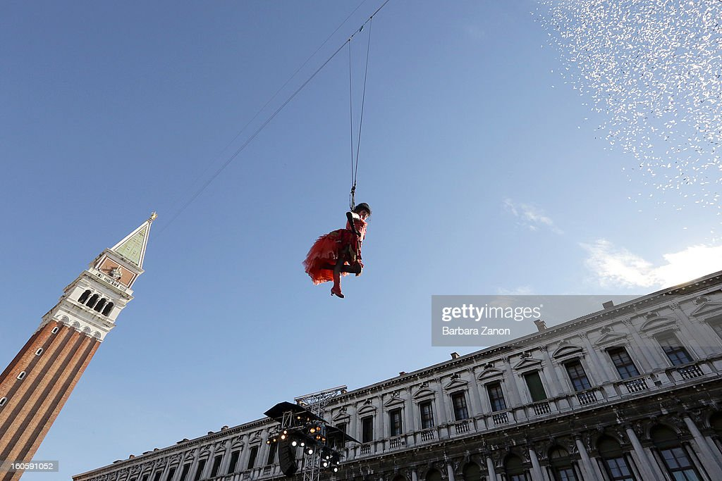 Venetian Marta Finotto performs as 'Colombina' during the Volo dell'Angelo , as she files down from San Marco Tower to the Square during the official opening of Venice Carnival at Piazza San Marco on February 3, 2013 in Venice, Italy. The Carnival which starts on February 2 and finishes on February 12, attracts thousands of tourists from all over the world.