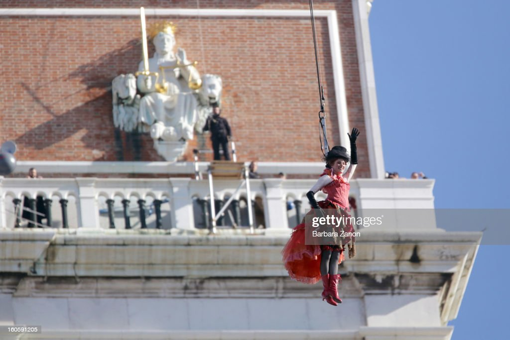 Venetian Marta Finotto performs as 'Colombina' during the Volo dell'Angelo, as she files down from San Marco Tower to the Square during the official opening of Venice Carnival at Piazza San Marco on February 3, 2013 in Venice, Italy. The Carnival which starts on February 2 and finishes on February 12, attracts thousands of tourists from all over the world.