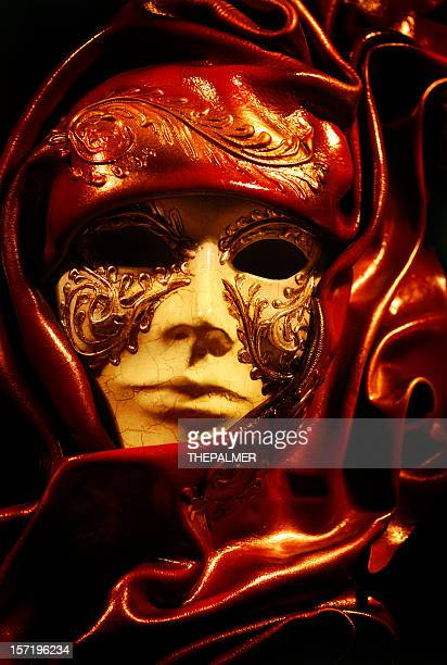 venetian mask on fire