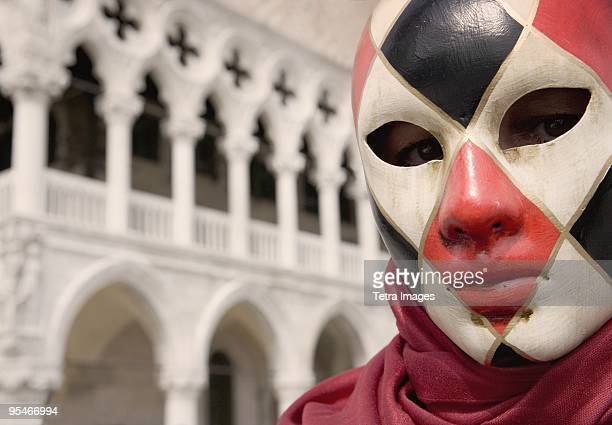 Venetian Mask, Venice. In the background is the Doge's Palace, Palazzo Ducale.