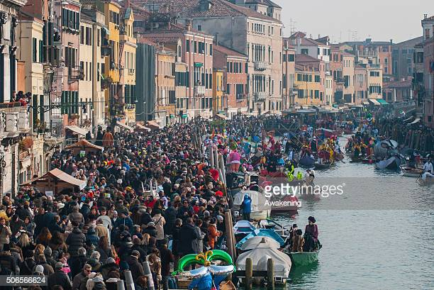 Venetians and tourists attend the Carnival Regatta on the opening day of the Venice Carnival on January 24 2016 in Venice Italy The 2016 Carnival of...