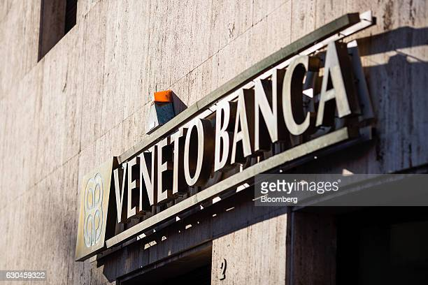 A Veneto Banca SpA company logo sits on a wall at a bank branch in Rome Italy on Friday Dec 23 2016 The nationalization of Banca Monte dei Paschi di...