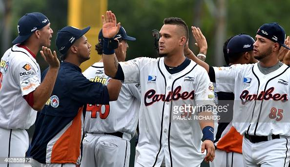 Venezuela National baseball players Oswaldo Arcia and Hassan Pena celebrate with the team after defeating the Mexico National baseball team 42 in the...