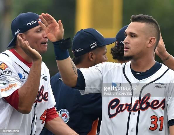 Venezuela National baseball team member Oswaldo Arcia shareS high fives with the team after defeating the Mexico National baseball team 42 in the...