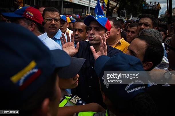 Venezuela opposition governor Henrique Capriles center shouts slogans during a protest demanding for a referendum to remove Venezuelan president...