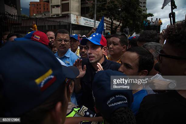 Venezuela opposition governor Henrique Capriles center speaks to members of the media during a protest demanding for a referendum to remove...