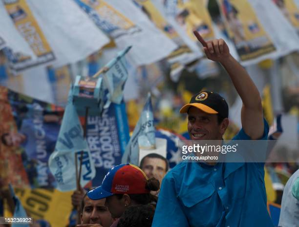 Venezuela opposition leader Henrique Capriles Radosnk greets his supporters during a rally in Puerto Ayacucho on October 01 2012 in Puerto Ayacucho...