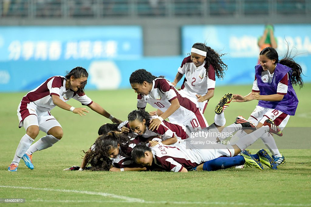 Venezuela players celebrates after they defeated Mexico 4-3 in the penalty shoot out after extra time during the 2014 FIFA Girls Summer Youth Olympic Football Tournament Semi Final match between Venezuela and Mexico at Wutaishan Stadium on August 23, 2014 in Nanjing, China.