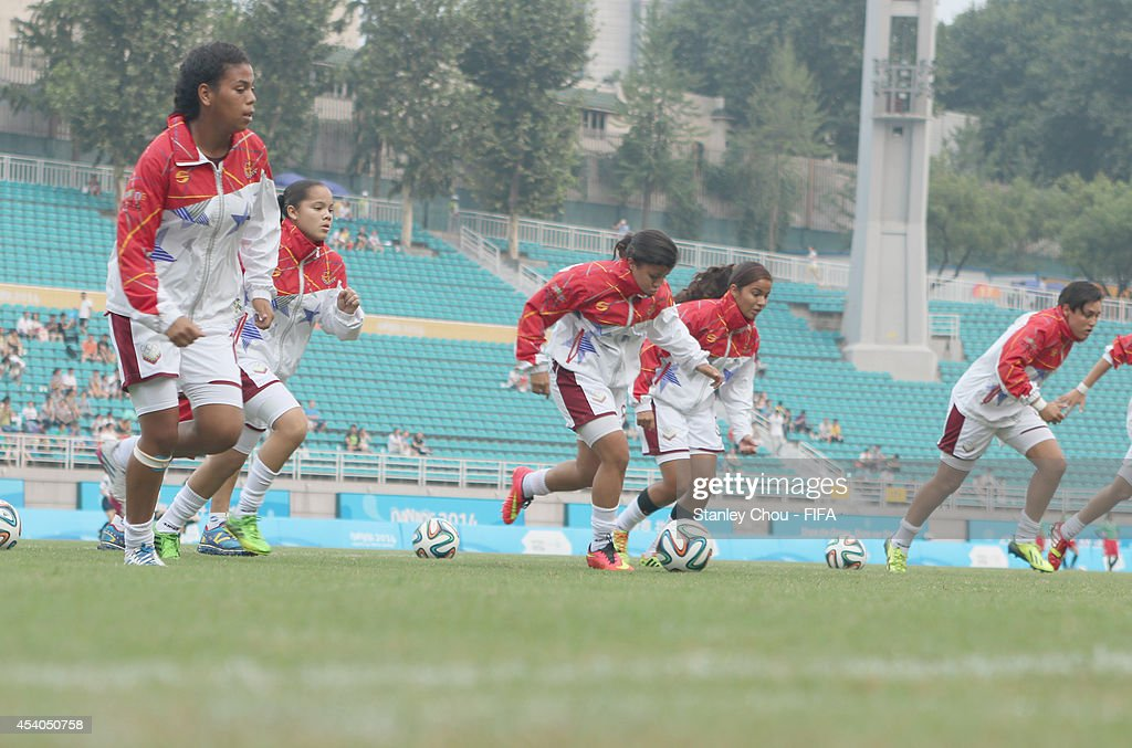Venezuela players in action during warm up prior to the start of the 2014 FIFA Girls Summer Youth Olympic Football Tournament Semi Final match between Venezuela and Mexico at Wutaishan Stadium on August 23, 2014 in Nanjing, China.