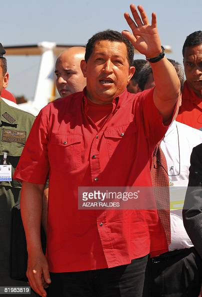 Venezuela President Hugo Chavez waves as he arrives at the airport of Riberalta a Bolivian city in the border with Brazil on July 18 2008 Chavez met...
