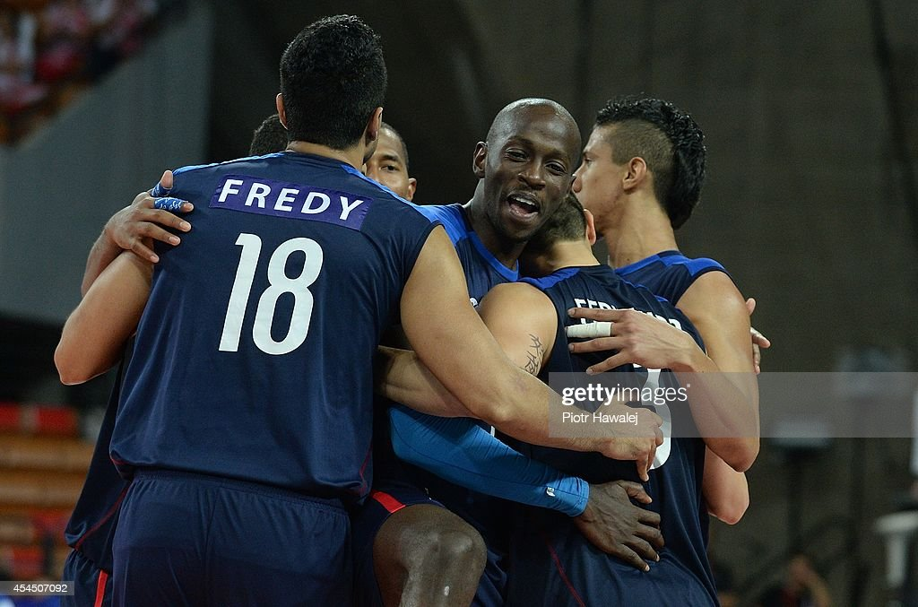 Venezuela team celebrate after winning a match during the FIVB World Championships match between Venezuela and Cameroon on September 2, 2014 in Wroclaw, Poland.