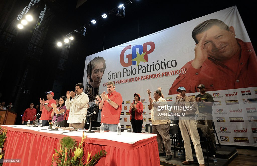 Venezuelan acting president Nicolas Maduro (C) applauds talks during a rally with leftist political parties in Caracas on March 20, 2013. Maduro, who succeeded the late Hugo Chavez as Venezuela's interim president, has an 18 point lead over the opposition's Henrique Capriles ahead of mid-April elections, a polling firm said Tuesday.