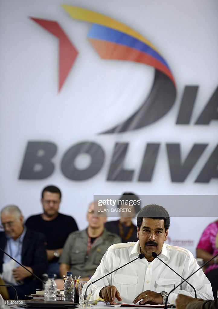 Venezuelan acting president Nicolas Maduro speaks during a meeting with intellectuals, in Caracas on March 25, 2013. Venezuela will elect its new president on April 14, 2013. AFP PHOTO