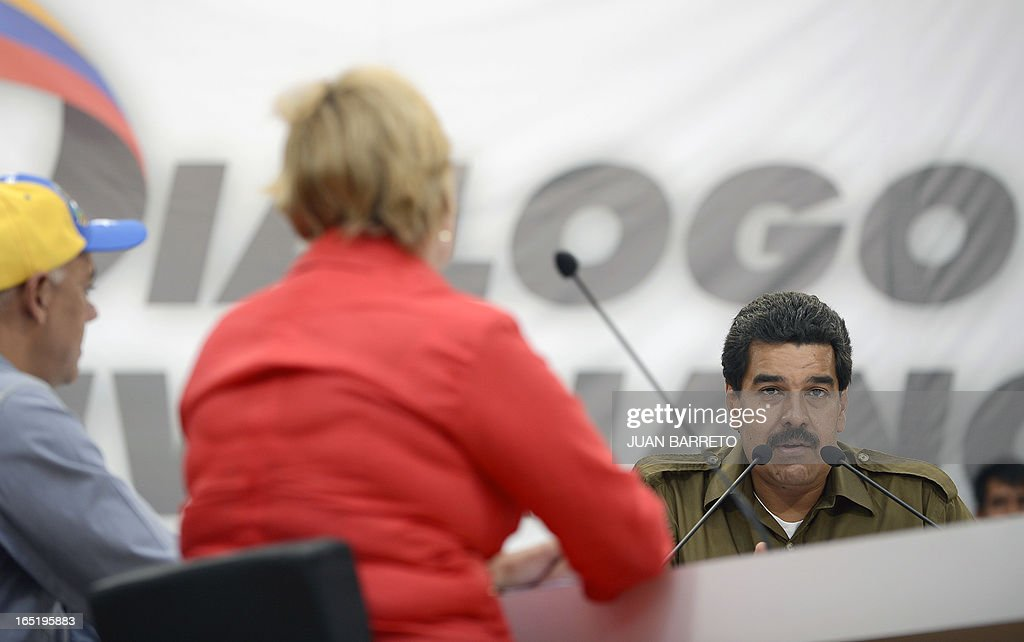 Venezuelan acting president Nicolas Maduro (R) speaks during a working session in Caracas on April 1st, 2013. Venezuela will hold presidential elections on April 14, 2013.