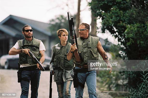 Venezuelan actor Edgar Ramirez British actress Keira Knightley and American actor Mickey Rourke on the set of Domino directed and produced by Tony...