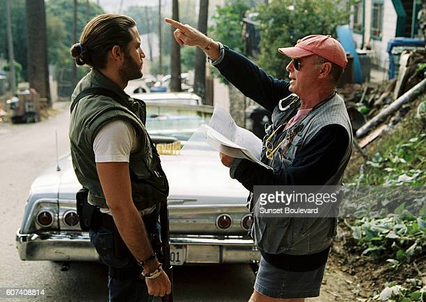 Venezuelan actor Edgar Ramirez with British director and producer Tony Scott on the set of his movie Domino