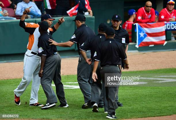 Venezuelan Aguilas del Zulia manager Lipso Nava argues with the referee during a Caribbean Baseball Series semifinal match against Criollos de Caguas...