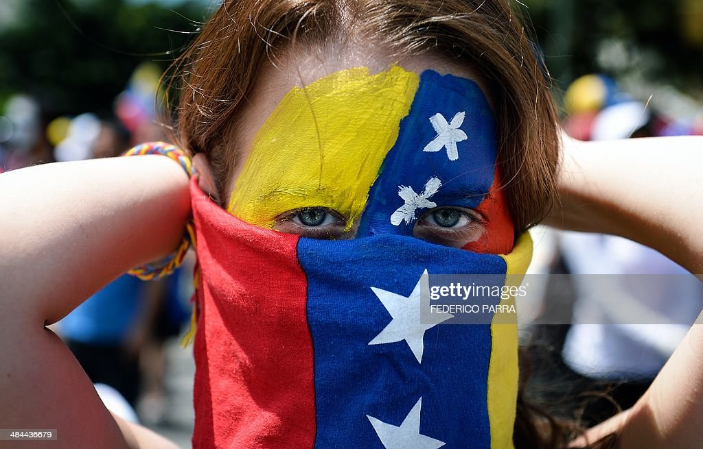 A Venezuelan anti-government activist takes part in a protest in Caracas on April 12, 2014. About 2,000 people took to the streets called by opposition leader --and recently dismissed deputy-- Maria Corina Machado.