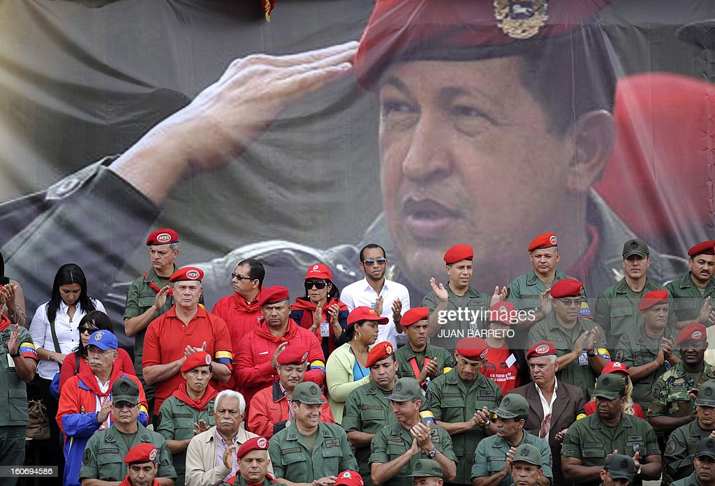 Venezuelan Army members take part in the conmemoration of the 1992 failed coup led by Chavez, who was an army lieutenant colonel, against then president Carlos Andres Perez, in Caracas, on February 4, 2013. Ailing President Hugo Chavez, who had cancer surgery in December, is doing much better and recovering, Cuban leader Fidel Castro said in remarks published Monday. AFP PHOTO/Juan BARRETO